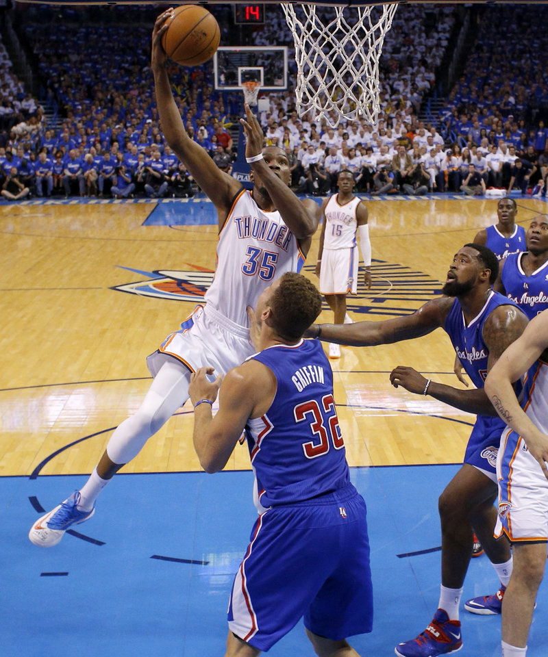 Photo - Oklahoma City's Kevin Durant (35) goes to the basket beside Los Angeles' Blake Griffin (32) during Game 2 of the Western Conference semifinals in the NBA playoffs between the Oklahoma City Thunder and the Los Angeles Clippers at Chesapeake Energy Arena in Oklahoma City, Wednesday, May 7, 2014. Photo by Bryan Terry, The Oklahoman