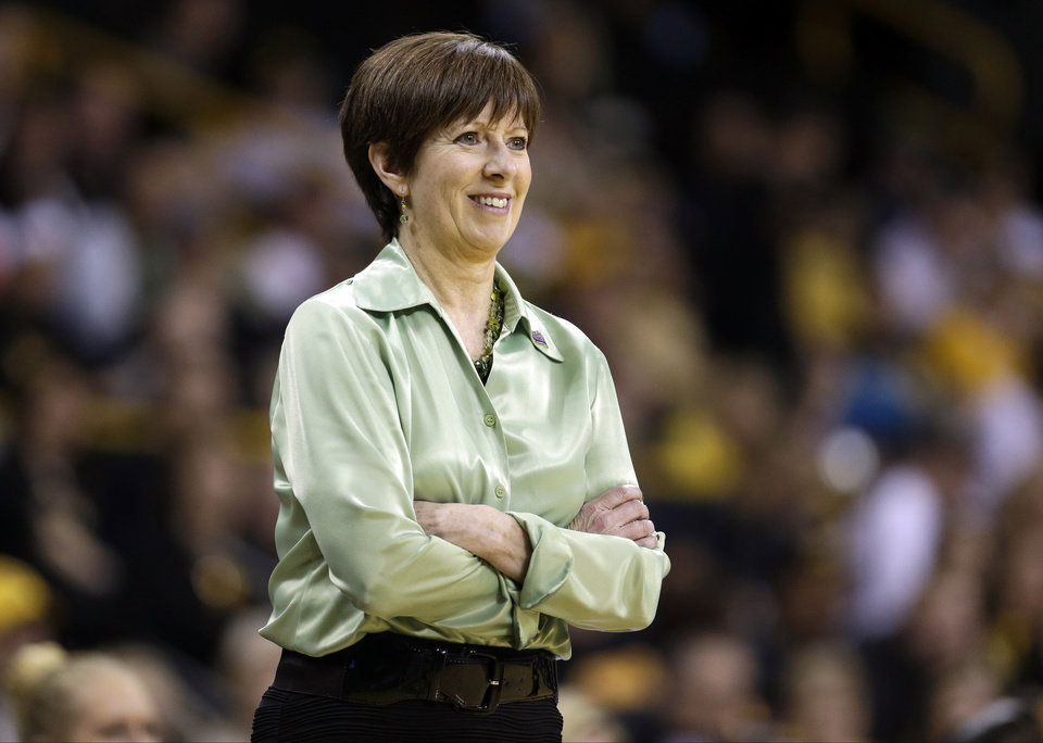 Photo - FILE - In this March 26, 2013, file photo, Notre Dame head coach Muffet McGraw looks on during the second half of a second-round game against Iowa in the women's NCAA college basketball tournament in Iowa City, Iowa. McGraw was selected as The Associated Press' women's basketball coach of the year on Saturday, April 6, 2013. (AP Photo/Charlie Neibergall, File)