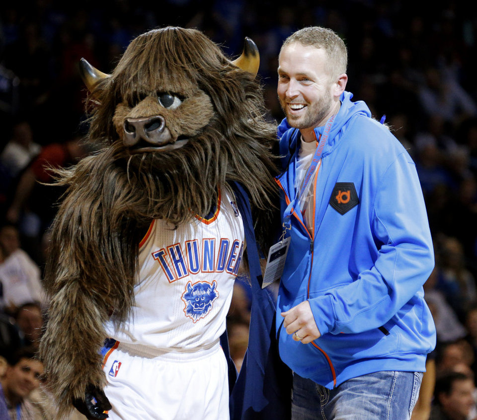 Photo - Former Oklahoma quarterback Jason White stands beside Rumble the Bison during an NBA basketball game between the Oklahoma City Thunder and the Minnesota Timberwolves at Chesapeake Energy Arena in Oklahoma City, Wednesday, Jan. 9, 2013.  Oklahoma City won 106-84. Photo by Bryan Terry, The Oklahoman