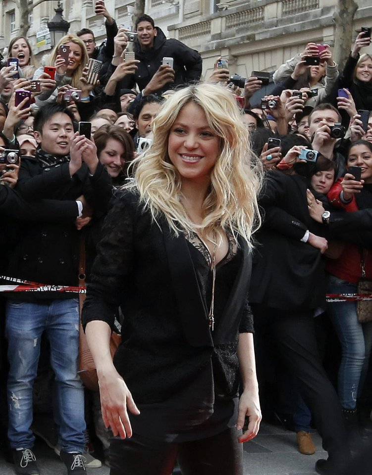 Photo - Shakira's signature hairstyle is big beachy curls.  Francois Mori