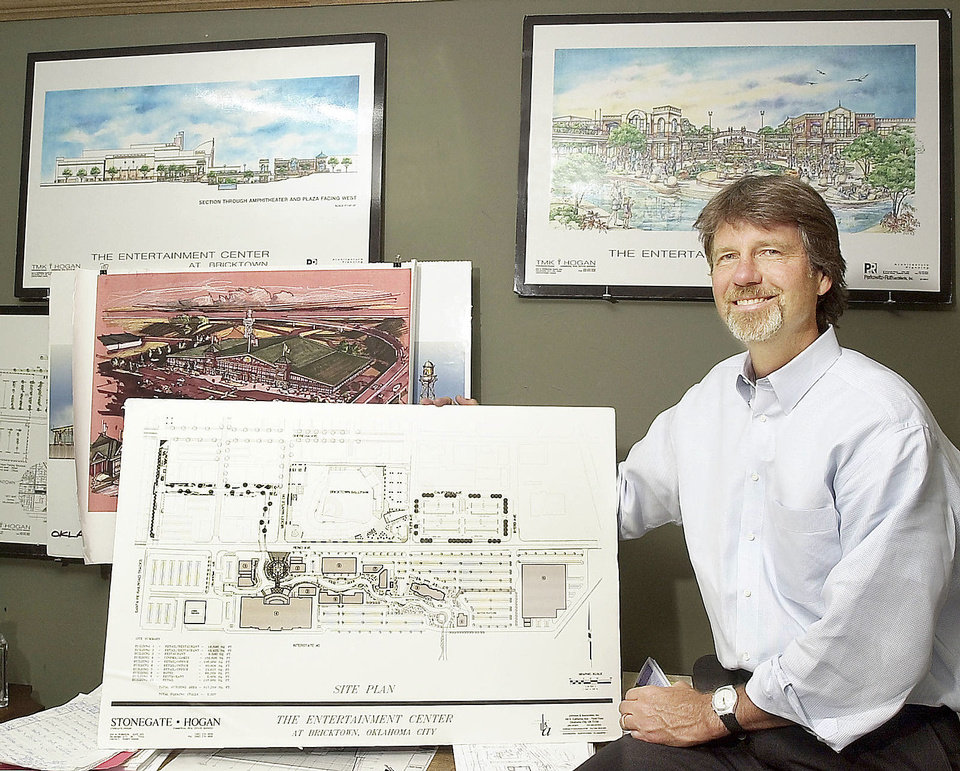 Randy Hogan is shown with early site plans and renderings for Lower Bricktown in this 2002 photo. Photo by PAUL B. SOUTHERLAND, The Oklahoman