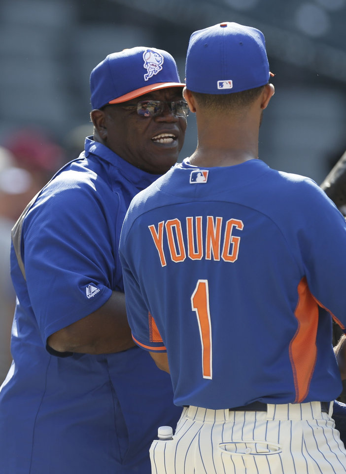 Photo - New York Mets batting coach Lamar Johnson talks to Chris Young (1) during batting practice before a baseball game against the Pittsburgh Pirates Tuesday, May 27, 2014, in New York.  (AP Photo/Frank Franklin II)