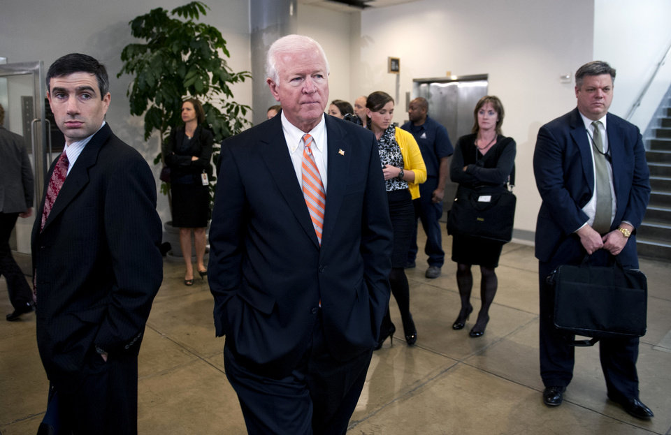 Photo -   Senate Intelligence Committee Vice Chairman Sen. Saxby Chambliss, R-Ga. leaves a the committee's closed-door hearing on Capitol Hill in Washington, Friday, Nov. 16, 2012, where former CIA Director David Petraeus testified on the Sept. 11, 2012 attack in Libya. (AP Photo/Cliff Owen)