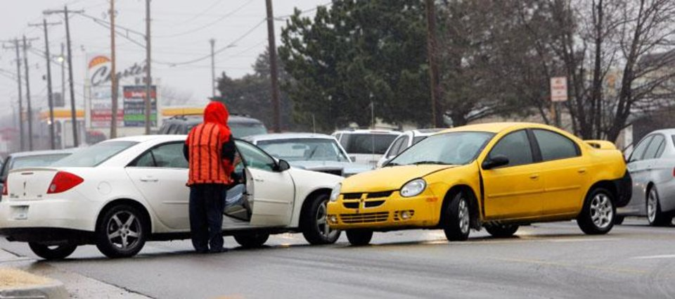 Photo -  A view of an accident in the 2700 block of west Britton Road due to the icy weather, Monday, January 26, 2009. BY DAVID MCDANIEL, THE OKLAHOMAN