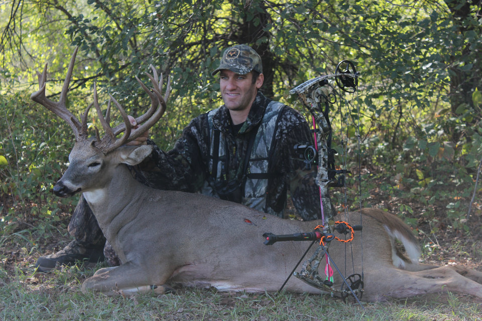 Bo Cocannouer of Tuttle with a big buck that he killed with a bow this season in Grady County. Oklahoma's deer gun season opens Saturday.