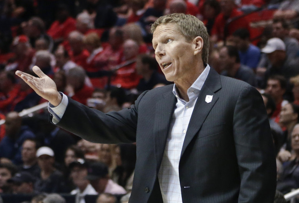 Photo - Gonzaga coach Mark Few makes a point with an official during the second half in a second-round game in the NCAA college basketball tournament against Oklahoma State on Friday, March 21, 2014, in San Diego. (AP Photo/Gregory Bull)