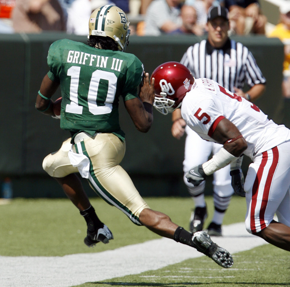 Nick Harris is called for a hit out of bounds on this run by Robert Griffin in the first half during the college football game between Oklahoma (OU) and Baylor University at Floyd Casey Stadium in Waco, Texas, Saturday, October 4, 2008.   BY STEVE SISNEY, THE OKLAHOMAN