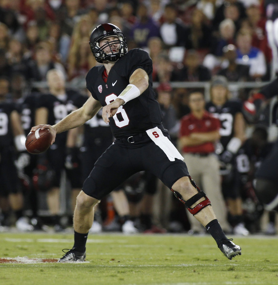 Photo - Stanford quarterback Kevin Hogan throws a pass against Washington during the first half of an NCAA college football game in Stanford, Calif., Saturday, Oct. 5, 2013. (AP Photo/George Nikitin)