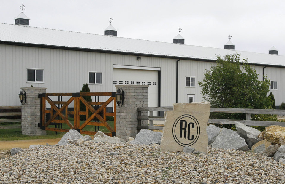 Photo -   This April 20, 2012 photo shows the horse ranch owned by Rita Crundwell outside of Dixon, Ill. Crundwell was recently fired from her Dixon comptroller job after her arrest by FBI agents on a charge of wire fraud. Crundwell lived two lives, as a small town city employee and a world champion horse breeder. Prosecutors say they've obtained bank records that document each step Crundwell took in shifting taxes and other city funds from account to account before finally hiding them in a secret account, as well as the checks and online payments made from it. (AP Photo/Charles Rex Arbogast)