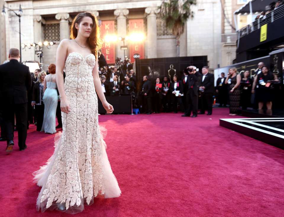 Actress Kristen Stewart in a dress by Reem Acra arrives at the Oscars at the Dolby Theatre on Sunday Feb. 24, 2013, in Los Angeles. (Photo by Matt Sayles/Invision/AP) <strong>Matt Sayles</strong>