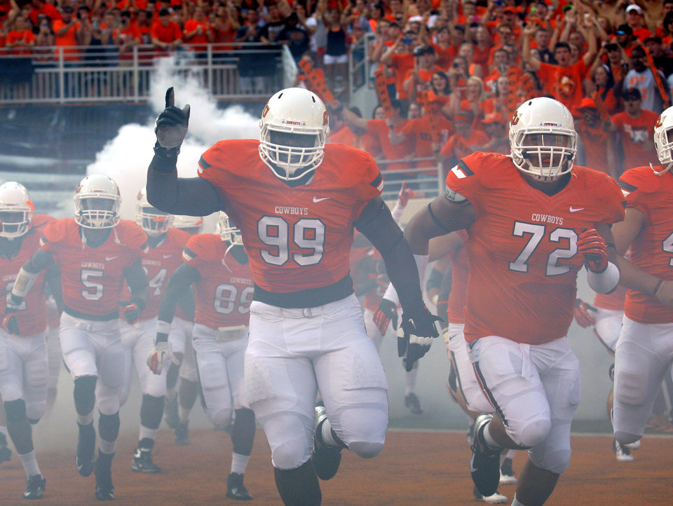 Oklahoma State's Calvin Barnett (99) runs on to the field before a college football game between Oklahoma State University (OSU) and Savannah State University at Boone Pickens Stadium in Stillwater, Okla., Saturday, Sept. 1, 2012. Photo by Sarah Phipps, The Oklahoman <strong>SARAH PHIPPS</strong>