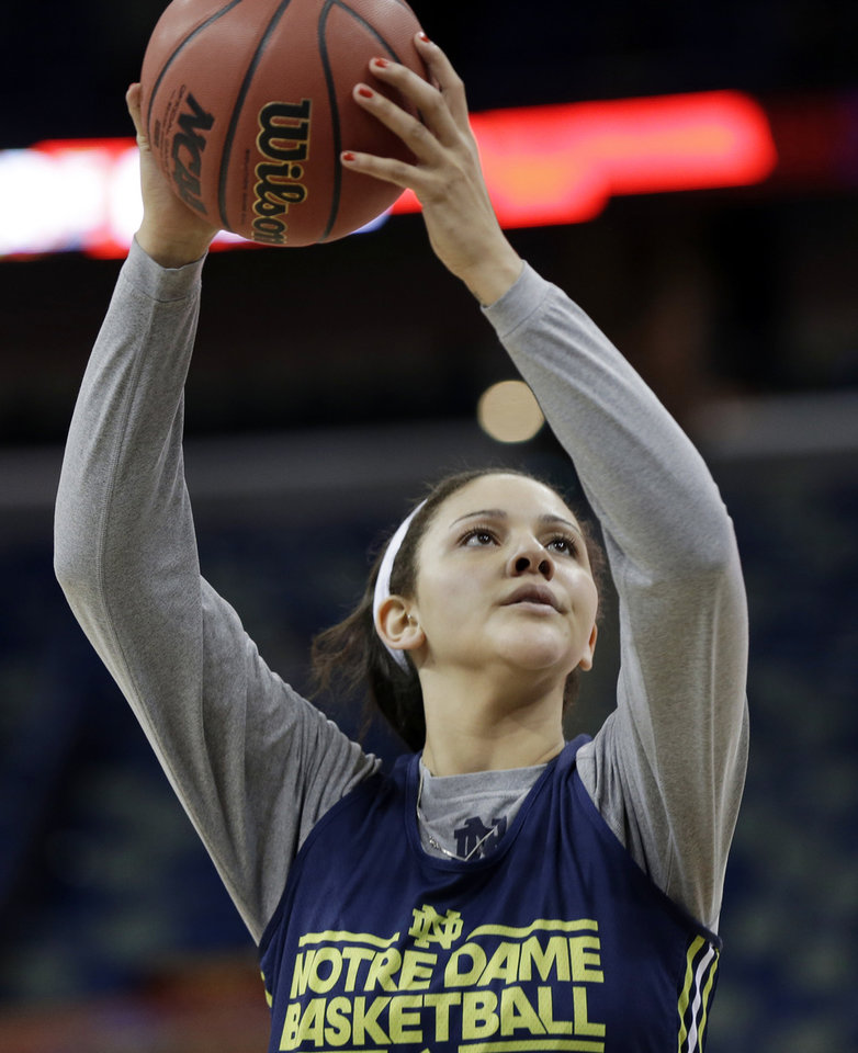 Photo - Notre Dame forward Natalie Achonwa shoots the ball during practice at the Women's Final Four of the NCAA college basketball tournament, Saturday, April 6, 2013, in New Orleans. Notre Dame plays Connecticut in a national semifinal on Sunday.  (AP Photo/Dave Martin)