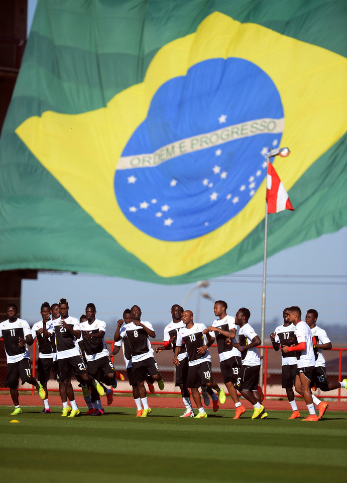 Photo - Ghana players practice on the pitch during a training session in Brasilia, Brazil, Wednesday, June 25, 2014. Ghana will play Portugal in group G of the 2014 soccer World Cup on June 26. (AP Photo/Paulo Duarte)