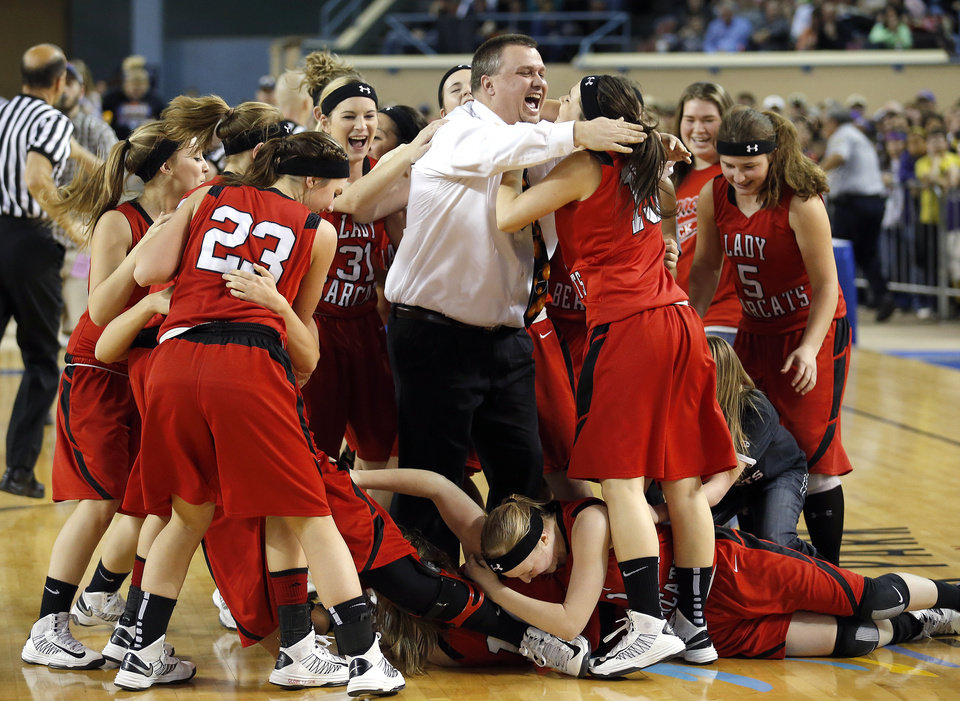 Erick celebrates the Class B girls state championship over Lomega at the State Fair Arena., Saturday, March 2, 2013. Photo by Sarah Phipps, The Oklahoman