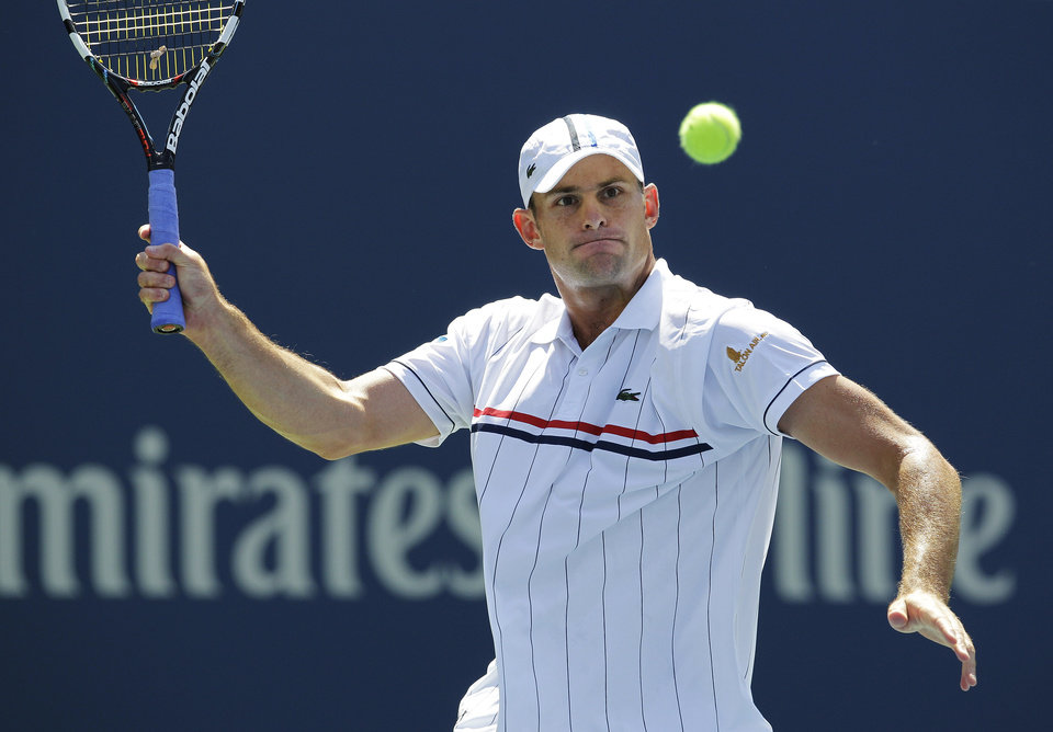 Andy Roddick returns a shot to Rhyne Williams at the 2012 US Open tennis tournament, Tuesday, Aug. 28, 2012, in New York. (AP Photo/Kathy Willens)