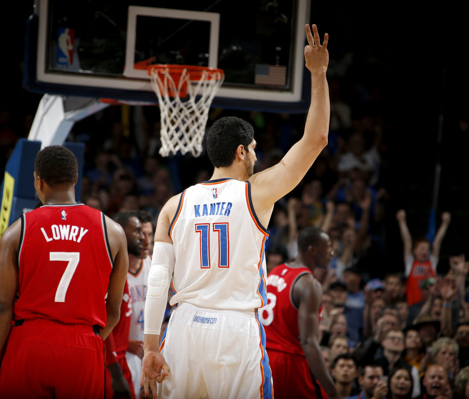 Photo - Oklahoma City's Enes Kanter (11) celebrates after a 3-point basket during an NBA basketball game between the Oklahoma City Thunder and the Toronto Raptors at Chesapeake Energy Arena on Wednesday, Nov. 4, 2015. The Thunder lost 103-98. Photo by Bryan Terry, The Oklahoman