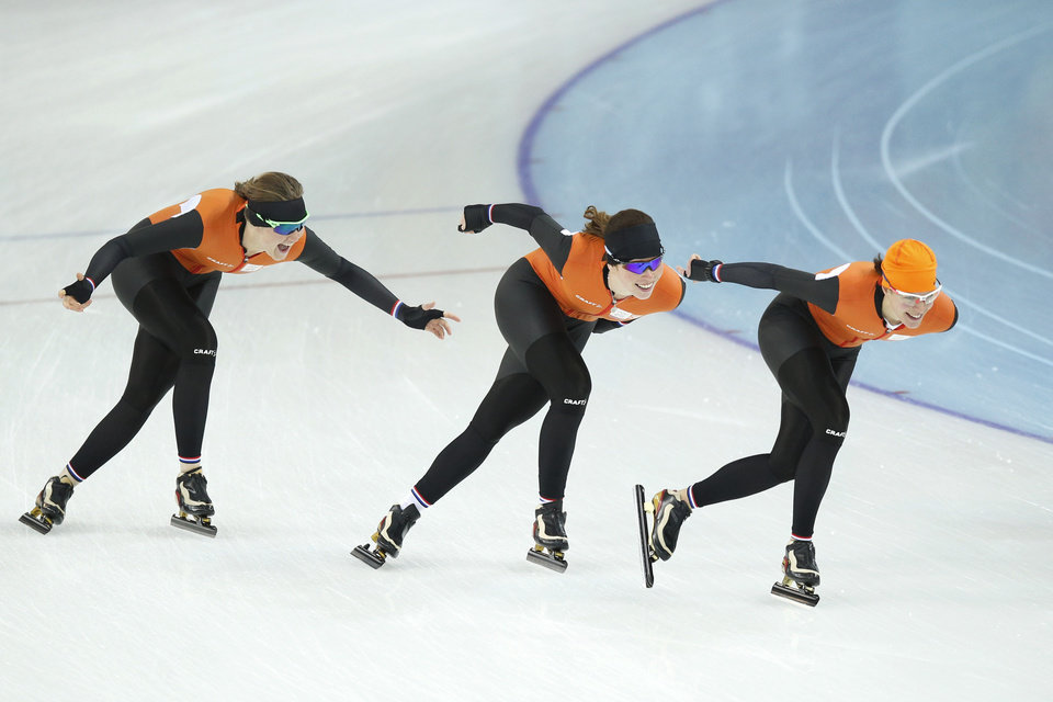 Photo - Lotte van Beek of the Netherlands, left, Antoinette de Jong, center, and Marrit Leenstra, joke as they practice at the Adler Arena Skating Center at the 2014 Winter Olympics, Friday, Feb. 14, 2014, in Sochi, Russia. (AP Photo/Pavel Golovkin)