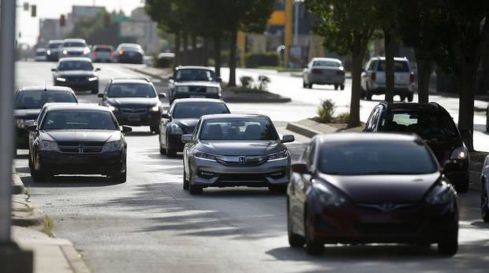 Photo -  Traffic moves along NW 23 in Oklahoma City on Tuesday. [Photo by Bryan Terry, The Oklahoman]