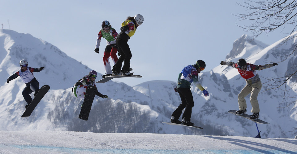 Photo - Lindsey Jacobellis, right,  of the United States leads during the women's snowboard cross semifinal at the Rosa Khutor Extreme Park, at the 2014 Winter Olympics, Sunday, Feb. 16, 2014, in Krasnaya Polyana, Russia. The other riders are, from left, Britain's Zoe Gillings, Italy's Michela Moioli, Canada's Dominique Maltais, Bulgaria's Alexandra Jekova, and Australia's Belle Brockhoff. (AP Photo/Luca Bruno)