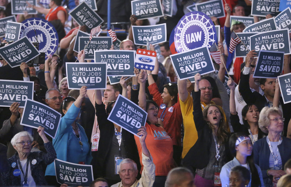 Photo - Delegates cheer during the Democratic National Convention in Charlotte, N.C., on Wednesday, Sept. 5, 2012. (AP Photo/Charles Dharapak)  ORG XMIT: DNC767