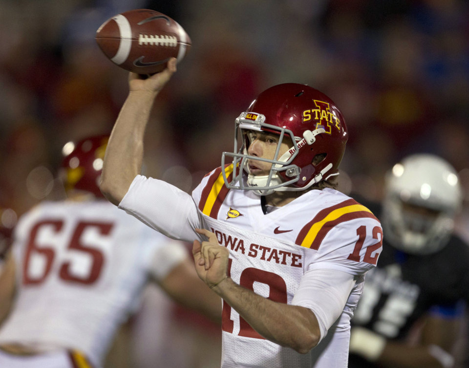 Iowa State quarterback Sam B. Richardson (12) passes to a teammate during the second half of an NCAA college football game against Kansas in Lawrence, Kan., Saturday, Nov. 17, 2012. Iowa State defeated Kansas 51-23. (AP Photo/Orlin Wagner)