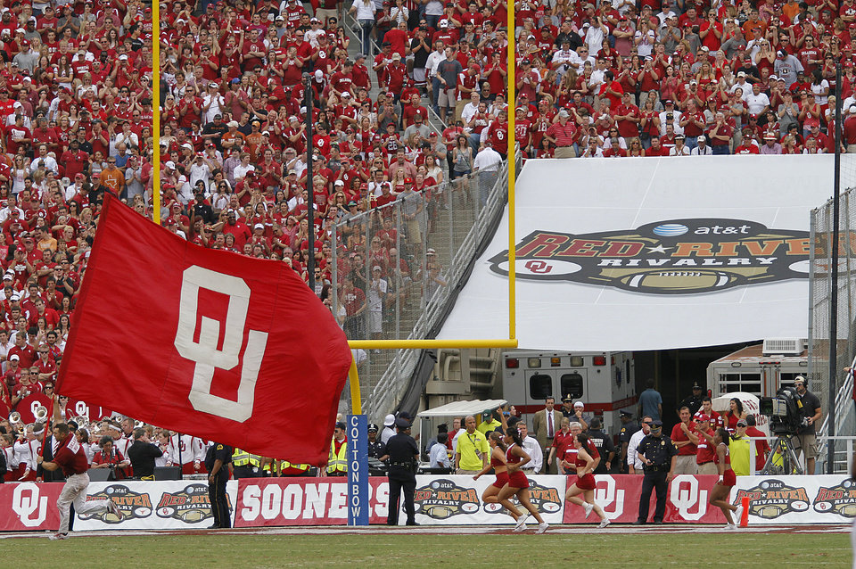 Photo - The OU flag waves during the Red River Rivalry college football game between the University of Oklahoma (OU) and the University of Texas (UT) at the Cotton Bowl in Dallas, Saturday, Oct. 13, 2012. Photo by Chris Landsberger, The Oklahoman