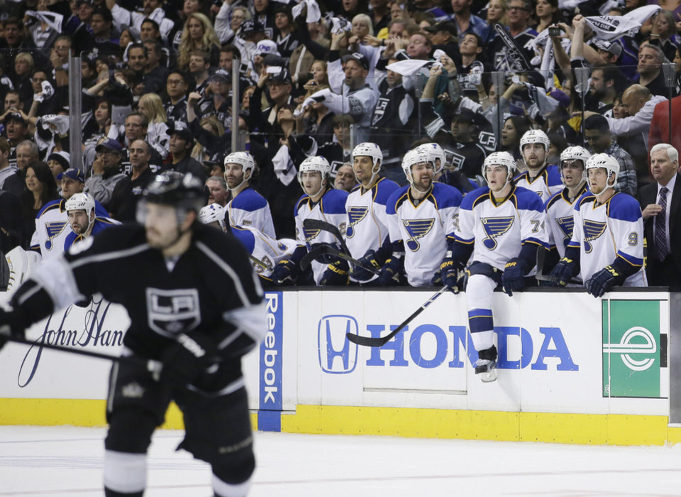 Photo - The St. Louis Blues players watch in the last seconds of Game 6 of a first-round NHL hockey Stanley Cup playoff series against the Los Angeles Kings in Los Angeles, Friday, May 10, 2013. The Kings won 2-1. (AP Photo/Jae C. Hong)