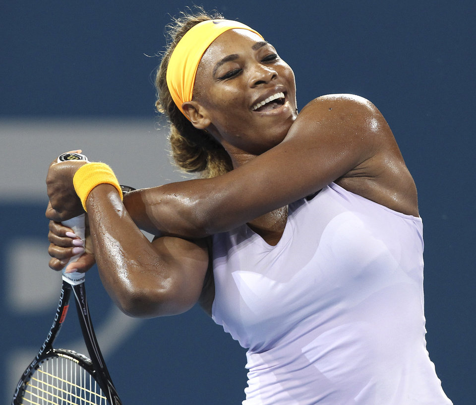 Photo - Serena Williams of the U.S. reacts after missing a point against Maria Sharapova of Russia in her semifinal match during the Brisbane International tennis tournament in Brisbane, Australia, Friday, Jan. 3, 2014. (AP Photo/Tertius Pickard)