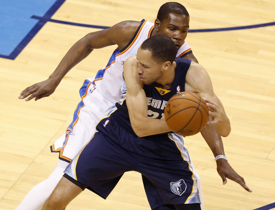 Photo - Oklahoma City's Kevin Durant (35) defends Memphis' Tayshaun Prince (21) during Game 1 in the first round of the NBA playoffs between the Oklahoma City Thunder and the Memphis Grizzlies at Chesapeake Energy Arena in Oklahoma City, Saturday, April 19, 2014. Photo by Nate Billings, The Oklahoman