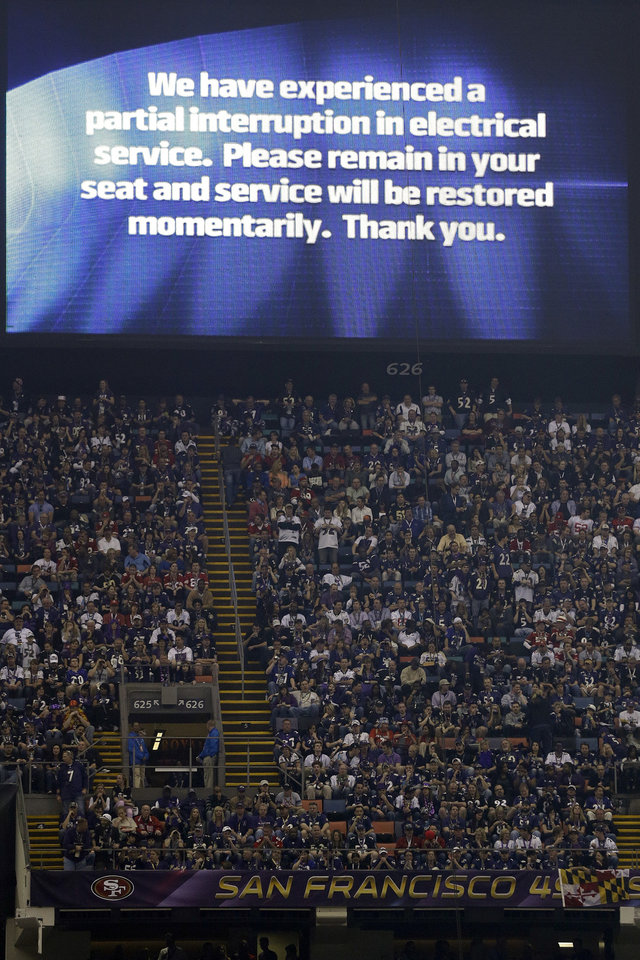 A power failure advisory appears on a screen at the Superdome during the second half of the NFL Super Bowl XLVII football game between the San Francisco 49ers and the Baltimore Ravens, Sunday, Feb. 3, 2013, in New Orleans. The power failure delayed the game by more than 30 minutes. (AP Photo/Marcio Sanchez)