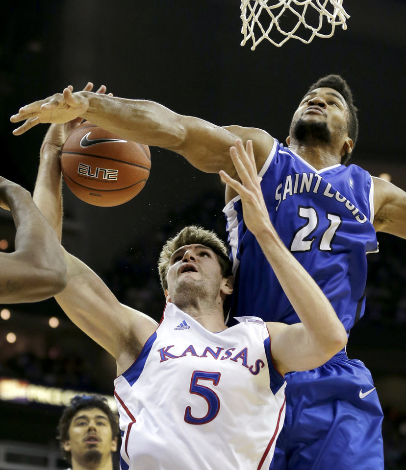 Photo -   Kansas center Jeff Withey (5) and Saint Louis forward Dwayne Evans (21) battle for a rebound during the first half of an NCAA college basketball game, Tuesday, Nov. 20, 2012, in Kansas City, Mo. (AP Photo/Charlie Riedel)