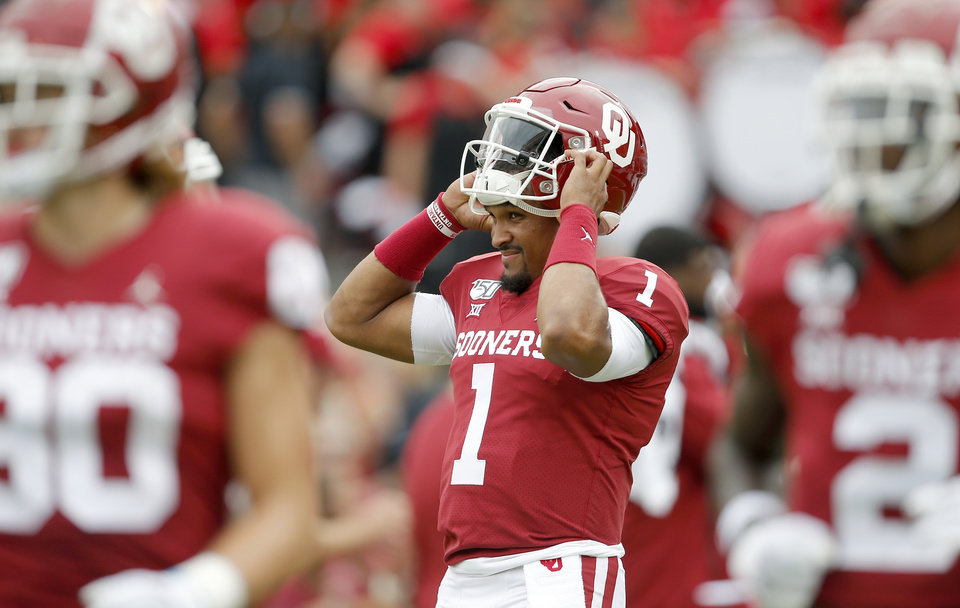 Photo - Oklahoma's Jalen Hurts (1) outs his helmet on before before a college football game between the University of Oklahoma Sooners (OU) and Texas Tech University at Gaylord Family-Oklahoma Memorial Stadium in Norman, Okla., Saturday, Sept. 28, 2019. [Bryan Terry/The Oklahoman]