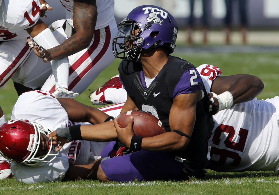 Oklahoma\'s Frank Shannon (20) and Stacy McGee (92) combine to bring down TCU\'s Trevone Boykin (2) during the college football game between the University of Oklahoma Sooners (OU) and the Texas Christian University Horned Frogs (TCU) at Amon G. Carter Stadium in Fort Worth, Texas, on Saturday, Dec. 1, 2012. Photo by Steve Sisney, The Oklahoman