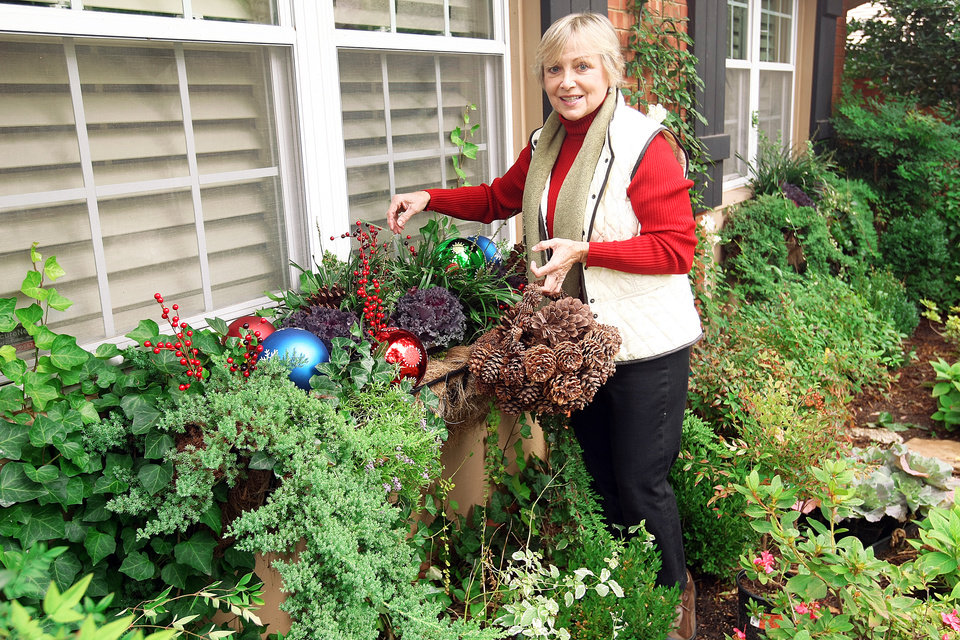 Judy Savage uses pinecones and other greenery from her garden in her holiday decorations. Photo by Hugh Scott, OPUBCO Communications Group