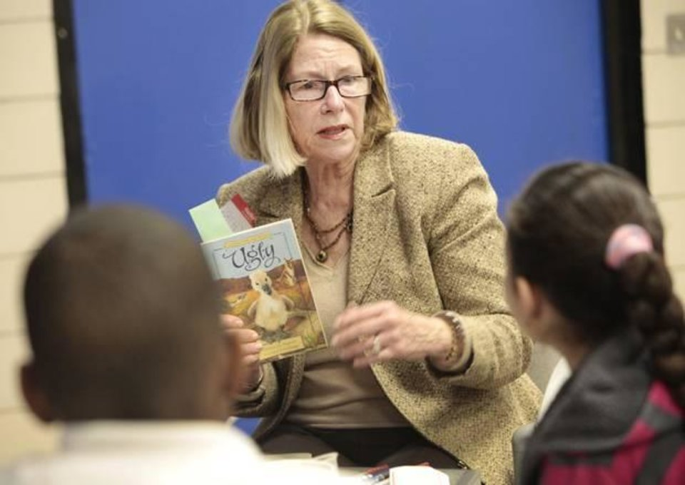 "Photo - Kathy Walker, from the Reading Club, reads ""Ugly"" to fifth-graders Thursday at Stanley Hupfeld  Academy."