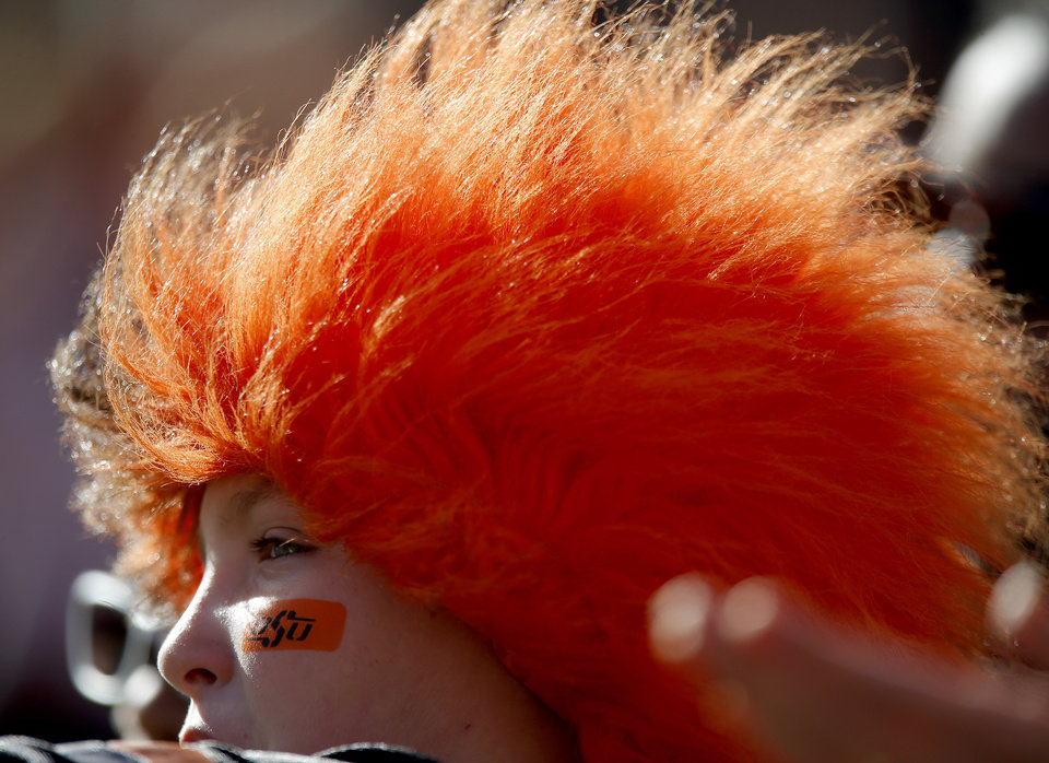 Photo - A OSU fan watches the field before a college football game between Oklahoma State University (OSU) and Texas Tech University (TTU) at Boone Pickens Stadium in Stillwater, Okla., Saturday, Nov. 17, 2012.  Photo by Bryan Terry, The Oklahoman