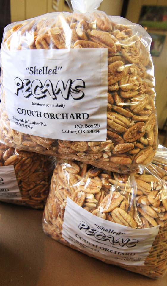 Photo - Shelled pecans bagged for sale in at Couch Orchard in Luther Monday, Dec. 23, 2013.  Photo by Paul B. Southerland, The Oklahoman