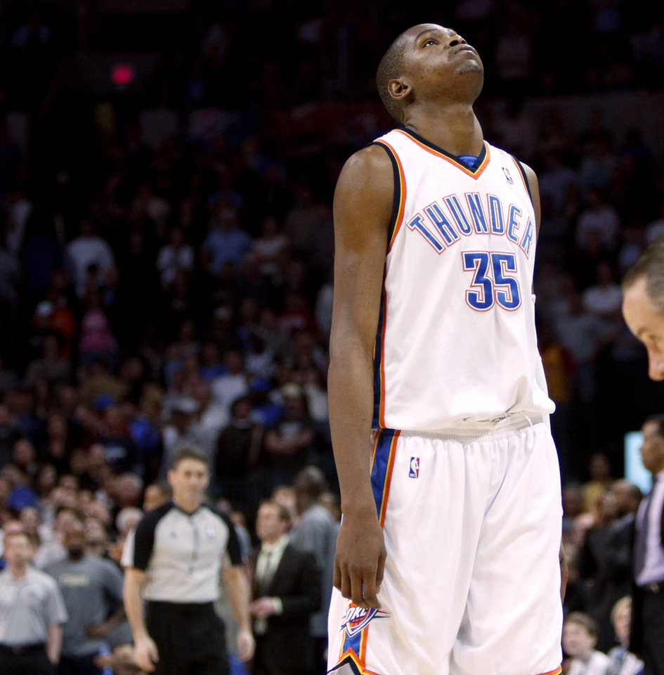 Photo - REACTION: Oklahoma City's Kevin Durant reacts after missing a shot in the final minute of  the NBA basketball game between the Oklahoma City Thunder and the Denver Nuggets at the Ford Center in Oklahoma City, Wednesday, April 7, 2010.  Photo by Bryan Terry, The Oklahoman ORG XMIT: KOD