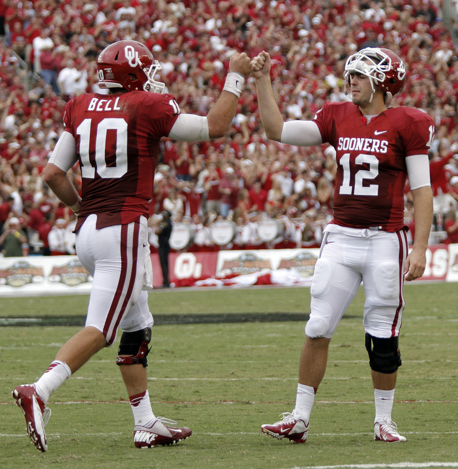 OU\'s Landry Jones (12) congratulates Blake Bell (10) after a touchdown during the Red River Rivalry college football game between the University of Oklahoma (OU) and the University of Texas (UT) at the Cotton Bowl in Dallas, Saturday, Oct. 13, 2012. Photo by Chris Landsberger, The Oklahoman