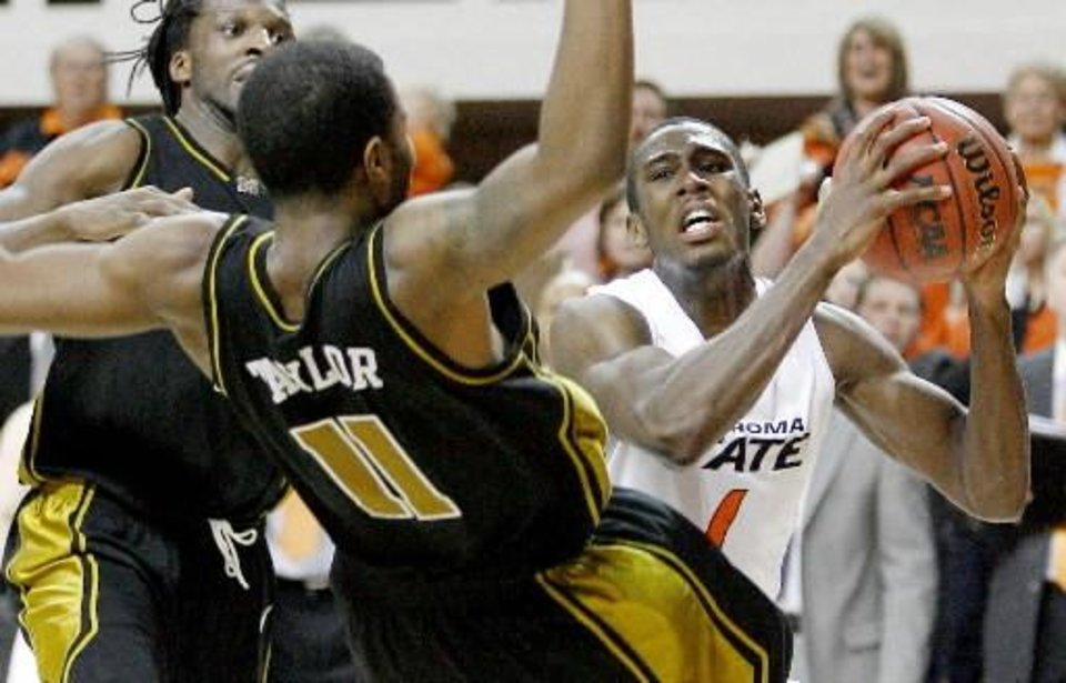 OSU\'s Terrel Harris tries to get around Missouri\'s DeMarre Carroll, left, and Zaire Taylor during the Big 12 college basketball game between Oklahoma State and Missouri at Gallagher-Iba Arena in Stillwater, Okla., Wednesday, Jan. 21, 2009. PHOTO BY BRYAN TERRY