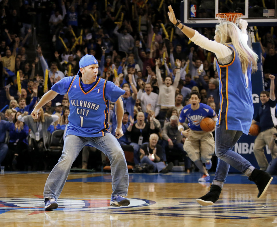Photo - Brad Brucker, a 33-year-old volleyball and soccer coach at Piedmont reacts after making a half-court shot for $20,000 from MidFirst Bank during an NBA basketball game between the Oklahoma City Thunder and the Los Angeles Clippers at Chesapeake Energy Arena in Oklahoma City, Thursday, Nov. 21, 2013. Oklahoma City won 105-91. Photo by Bryan Terry, The Oklahoman