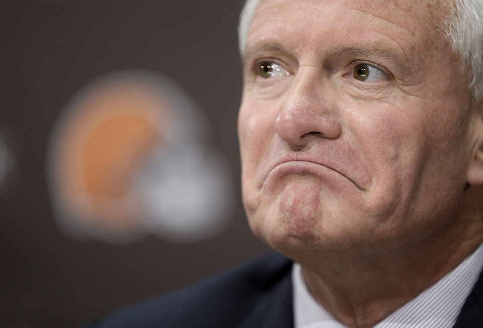 Photo - Cleveland Browns owner Jimmy Haslam listens to a question during a news conference Tuesday, Feb. 11, 2014, in Berea, Ohio. Haslam announced Tuesday that CEO Joe Banner will step down in the next two months and general manager Michael Lombardi is leaving the team. Haslam also said assistant GM Ray Farmer, who was pursued by Miami to be the Dolphins' GM this winter, has been promoted to general managerand will immediately take the over the team's football operations and lead the Browns during free agency and draft. (AP Photo/Tony Dejak)