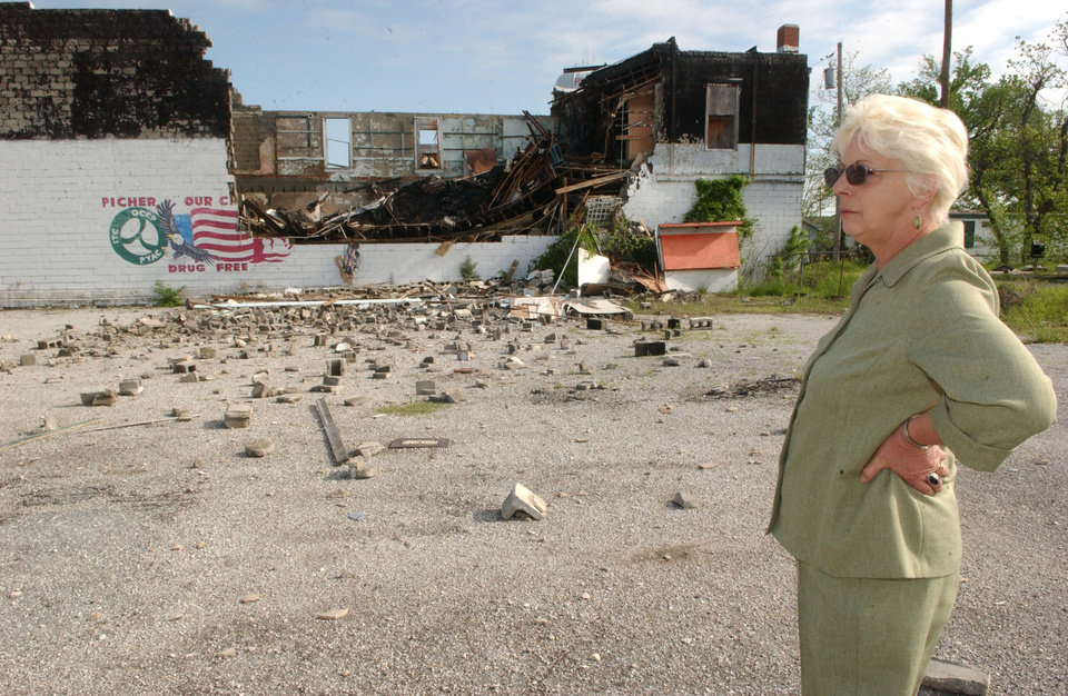 Photo - Gloria Garner, owner of the building, surveys the damage. Photo by Gary Crow, for The Oklahoman