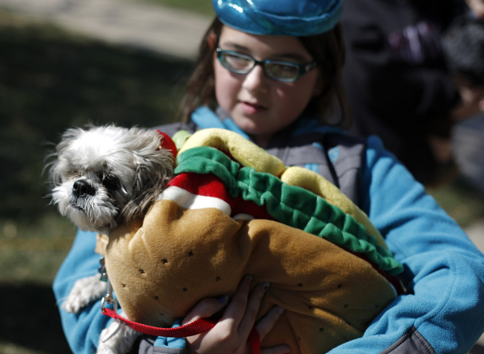 Avery Stien, 10 of Yukon, dressed as a crayon, holds her dog Sebastian during a dog and child costume show at the Yukon Community Center in Yukon, Okla., Saturday, Oct. 27, 2012.  Photo by Garett Fisbeck, The Oklahoman