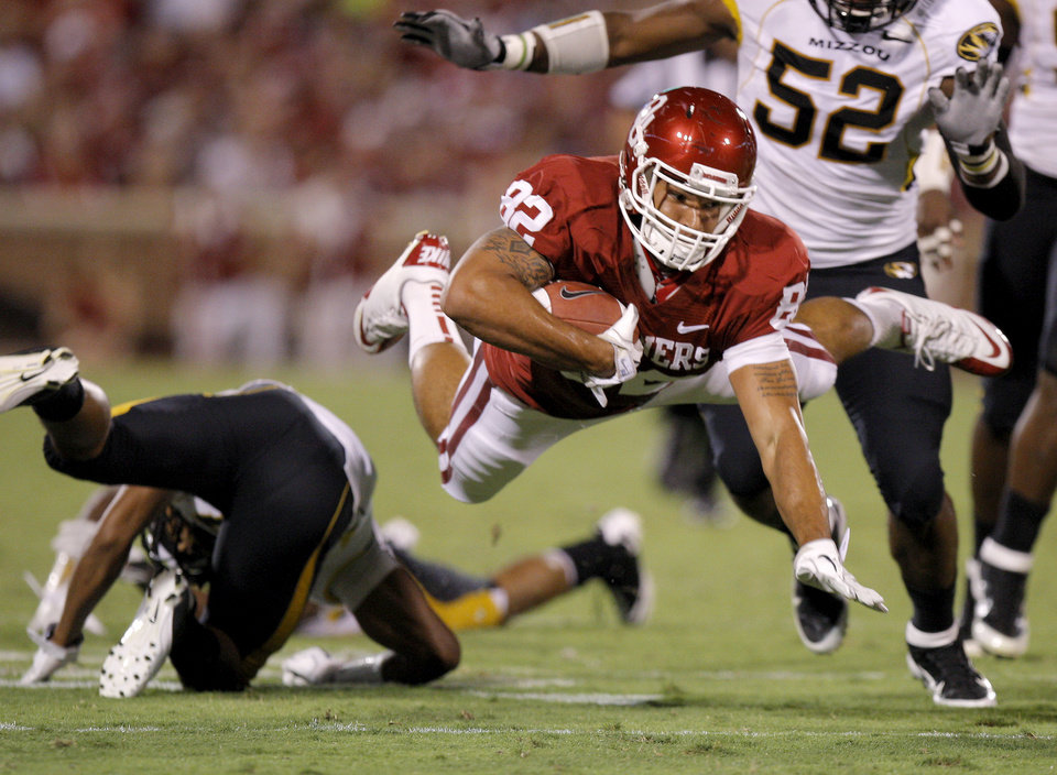 Oklahoma\'s James Hanna leaps for more yards after making a catch during the Sooners\' game vs. Missouri on Saturday in Norman. Photo by Bryan Terry, The Oklahoman