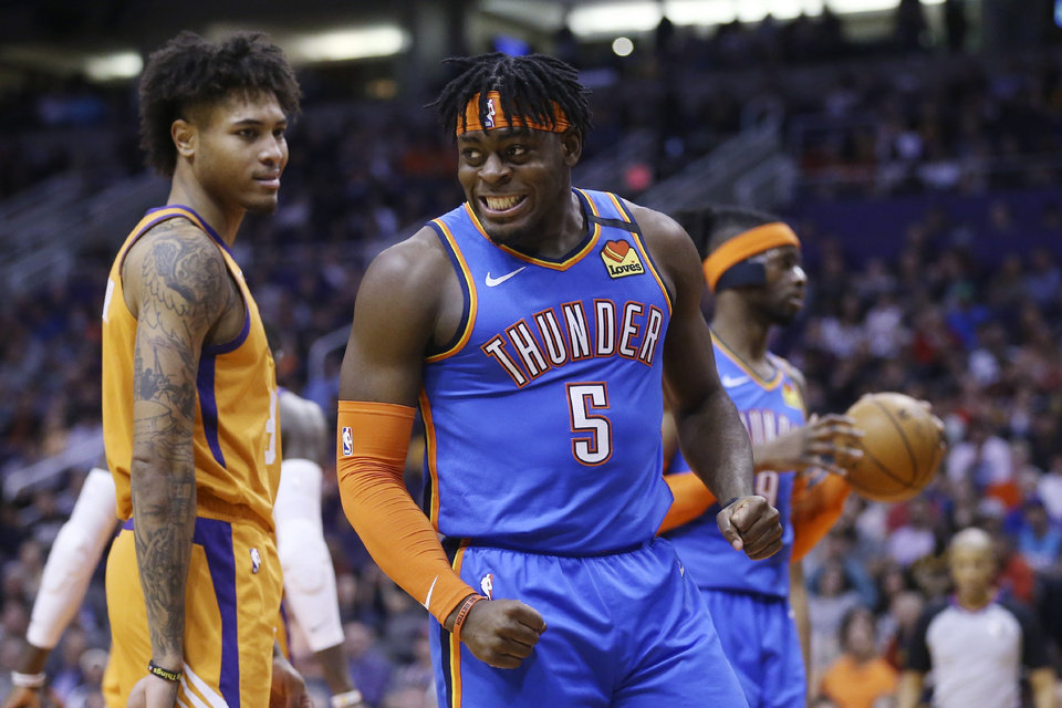Photo - Oklahoma City Thunder guard Luguentz Dort (5) shouts after being fouled by Phoenix Suns forward Kelly Oubre Jr., left, as Thunder center Nerlens Noel, right, holds the ball during the first half of an NBA basketball game Friday, Jan. 31, 2020, in Phoenix. (AP Photo/Ross D. Franklin)