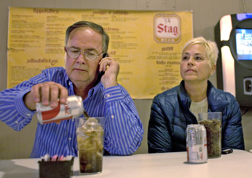 Photo - In this March 19, 2014 photo, former Illinois Department of Natural Resources official and unsuccessful Democratic candidate for the 115th Illinois house district, Tony Mayville, and his wife, Charlotte, waiting for results election night at Scheller Playhouse in Scheller, Ill. Illinois Department of Natural Resources spokesman Chris Young confirmed Friday, April 18, that Tony Mayville was dismissed this week from his position as supervisor of mine safety enforcement with the DNR's Office and Mines and Minerals. (AP Photo/The Southern Illinoisan, Steve Matzker)
