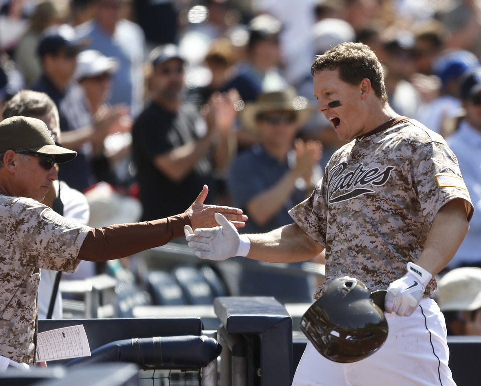 Photo - San Diego Padres' Nick Hundley returns to the dugout after his solo home run against the San Francisco Giants in the seventh inning a baseball game Sunday, April 20, 2014, in San Diego.  (AP Photo/Lenny Ignelzi)