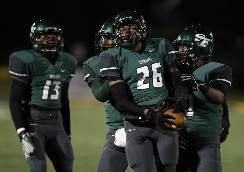 Santa Fe\'s Jalaun Parker (26) celebrates with his teammates during a high school football game between Edmond Memorial and Edmond Santa Fe at Wantland Stadium in Edmond, Okla., Friday, Oct. 26, 2012. Photo by Garett Fisbeck, The Oklahoman