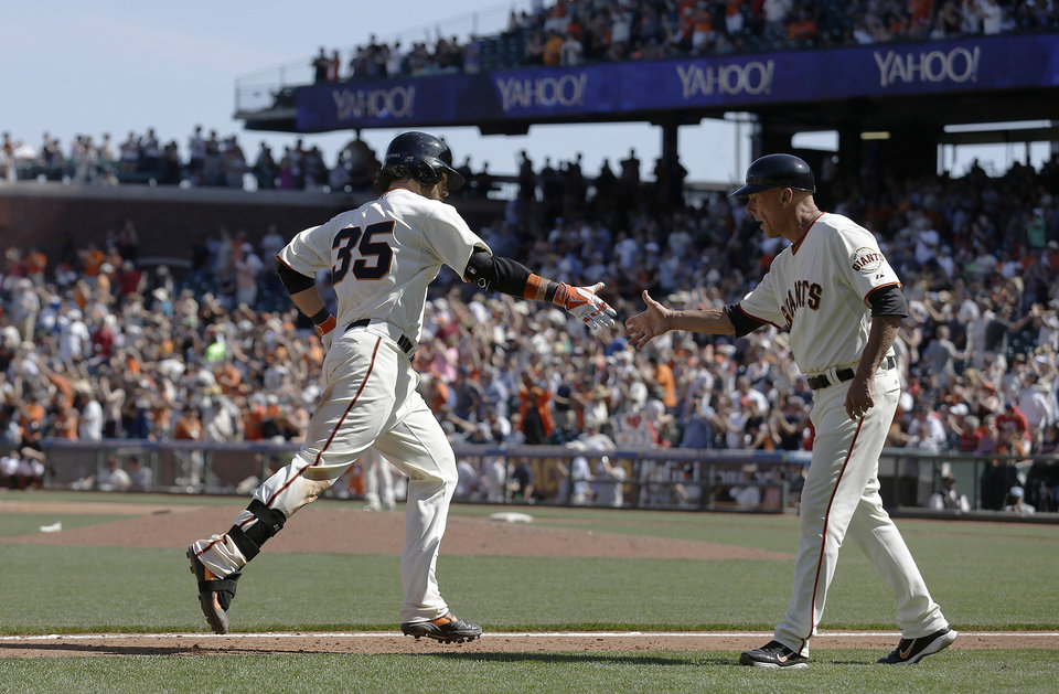 Photo - San Francisco Giants' Brandon Crawford (35) is congratulated by third base coach Tim Flannery after hitting a two-run home run off of Atlanta Braves pitcher David Carpenter during the eighth inning of a baseball game in San Francisco, Wednesday, May 14, 2014. The Giants won 10-4. (AP Photo)